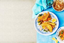 Breaded fish with crispy vegetables and herbs