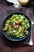 Spinach and cheese Spätzle (soft egg noodles from Swabia) with onions