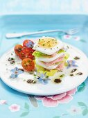 A stack of lettuce, ham and hard-boiled egg