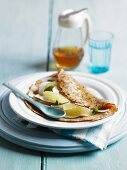 Coconut pancake with grapefruit and agave syrup
