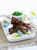 Lamb kebabs with tzatziki and rocket