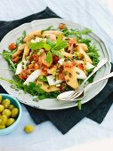 Melon salad with oranges, rocket and pumpkin seeds