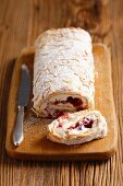 Sponge roll with cranberry jam and cream