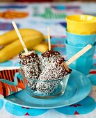 Frozen bananas with a chocolate and coconut glaze