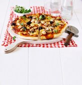 Chicken, olive and mushroom pizza