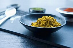 Green curry powder in an elegant oriental bowl