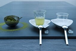 Green tea powder in a bowl, tea and crockery and white rock sugar