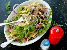 Pasta salad with salami and rocket