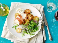 Pork fillet wrapped in ham with fried potatoes