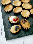 Madeleines with berries and chocolate