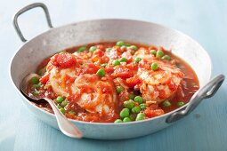 Chicken breast in tomato sauce with peas