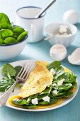 A spinach and goats cheese omelette with ingredients