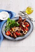 Sausages with beans and grilled tomatoes