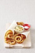 Fried onion rings in beer batter with a dip