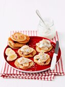 Raspberry pancakes topped with banana, vanilla yogurt and grated coconut