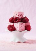 Raspberry marshmallow cubes with fresh raspberries on a mini cake stand
