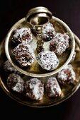 Dark chocolate truffles on a cake stand