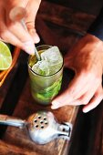 A mojito being made (sugar being stirred in)