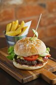 Cheeseburger with bacon and chips