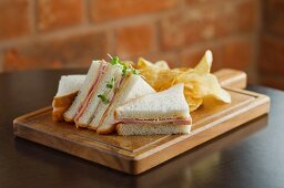 Ham sandwiches with crisps