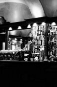 The interior of an Italian bar with bottles and an espresso machine