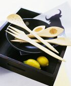 Decorative hand-carved cutlery made from orange wood