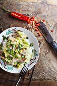 Pad-kla-lam-plee (braised white cabbage on a bed of rice with pork and spices, Thailand)