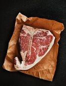 Porterhouse steak on a piece of paper