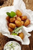 Potato doughnuts with a wild herb dip