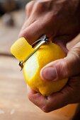 A lemon being peeled