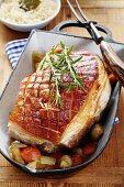 Crispy roast pork with vegetables and sauerkraut