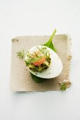 An egg with herb cream and shrimps