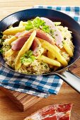 Fried potato orzo pasta with gammon and sauerkraut