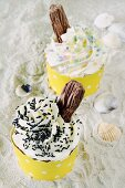 A blueberry cupcake and a yogurt cupcake