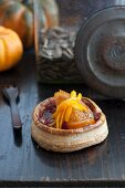 Puff pastry with a aronia jam and candied orange