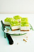 Slices of sour cream cake with green apple jelly