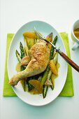 Braised chicken with asparagus and oranges