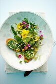 Spicy herb salad with flowers and chive croutons