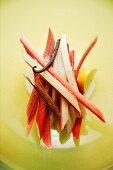 Sliced rhubarb with cinnamon sticks, lemon and a vanilla pod