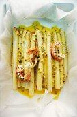 Asparagus braised in paper with fried langoustines