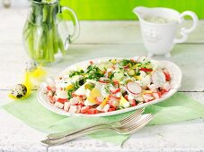 Surimi salad with eggs, gherkins and tartare sauce