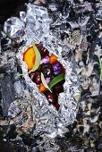Grilled fruit wrapped in tin foil