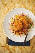 Turkey escalope with a cornflakes coating served with a colourful raw vegetable salad