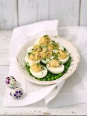 Stuffed eggs on peas for an Easter brunch