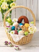 An Easter basket filled with bread, sausage and eggs