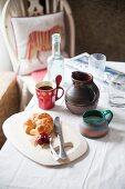 Breakfast with croissants, jam, coffee, newspapers