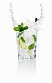 A Gin & Tonice splashing out of the glass