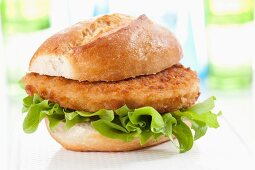 A bread roll filled with an escalope and lettuce