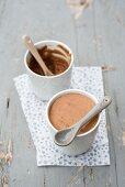 Two pots of caramel mousse