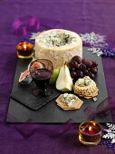Stilton cheese with crackers, fruit and Port wine